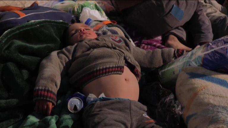 A boy sleeping in al Houl camp in Syria