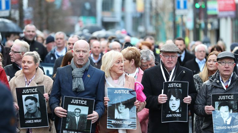 Families of those who died march through the Bogside estate in Londonderry
