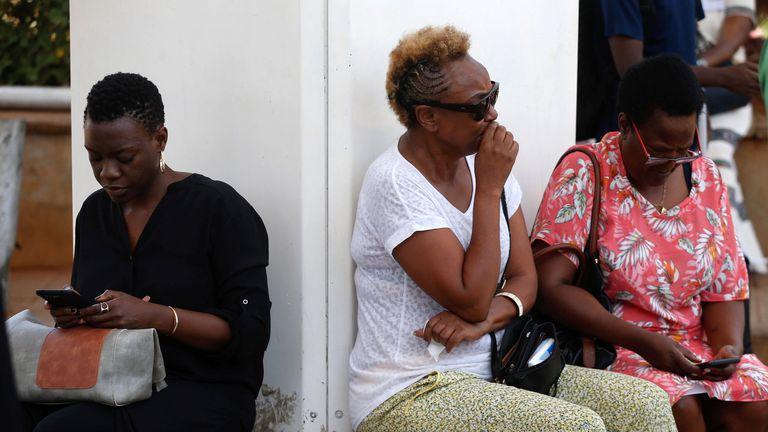 Relatives wait for information at Jomo Kenyatta International Airport in Nairobi, Kenya