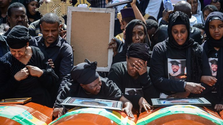 Mourners of victims of the crashed Ethiopian Airlines flight at a mass funeral in Addis Ababa