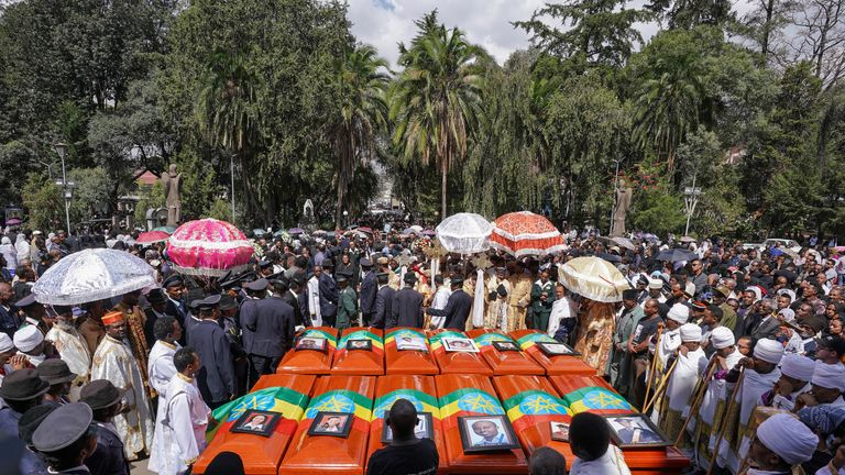 Twelve of the 17 coffins are laid out in front of the church in Addis Ababa