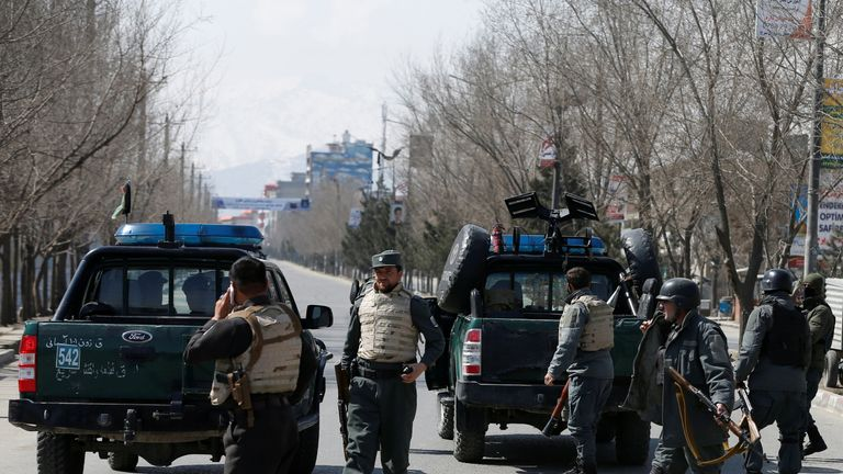 Police patrol at the site of a mortar attack in Kabul in March which has been blamed on IS