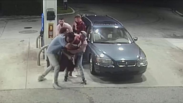 A group of spring breakers tackled a gunman trying to rob them, successfully driving the robber and his accomplice away.