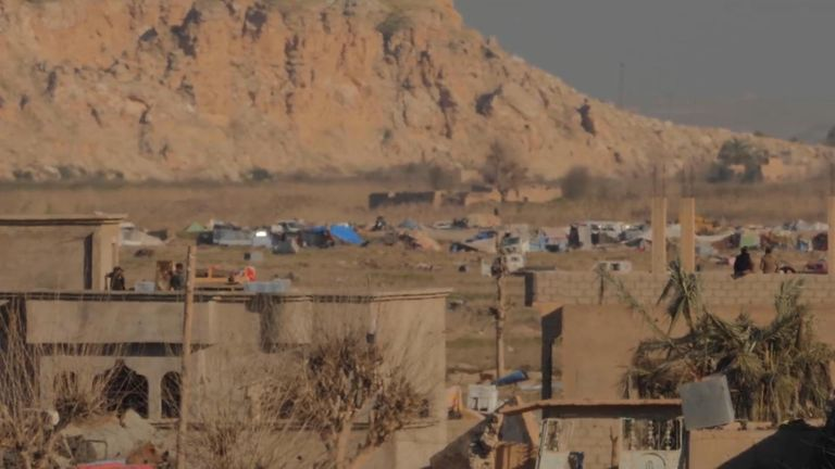 During the day, when the fighting stops, a makeshift tent city housing lS families is visible in the distance