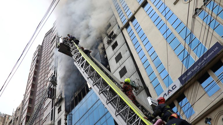 People are rescued as fire broke out at a multi-storey commercial building in Dhaka, Bangladesh