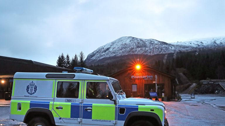A Police vehicle at the Nevis Range Mountain Resort with Ben Nevis behind where two climbers have died and another two have been injured after an avalanche