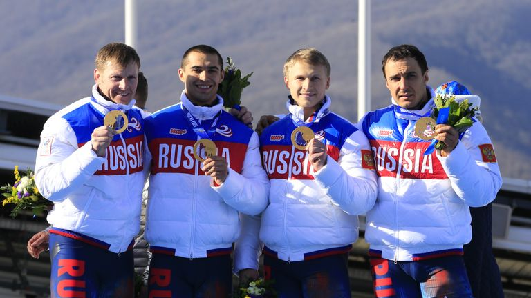 The Russian four-man bobsleigh team celebrate with their gold medals