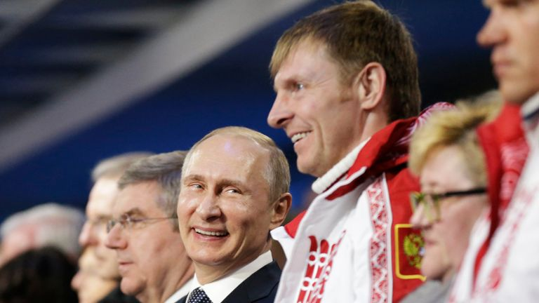 Russian President Vladimir Putin (C) shares a joke with Alexander Zubkov, who won gold in the two and four-man bobsleigh for Russia
