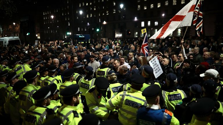 Protesters clash with police in Parliament Square