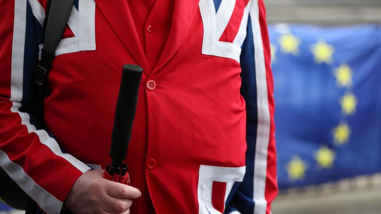 A pro-Brexit supporter wearing a Union Jack suit in Westminster
