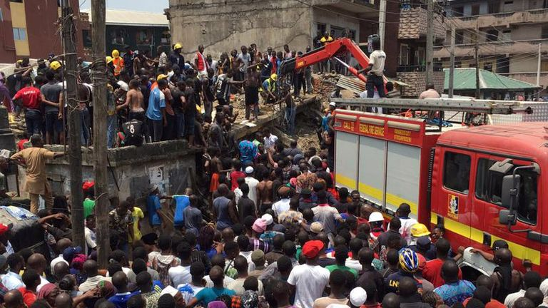 Rescue workers attend the collapsed building