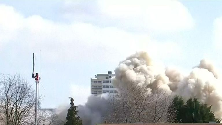 Plume of dust rises from the demolition of a high-rise building in Duisburg