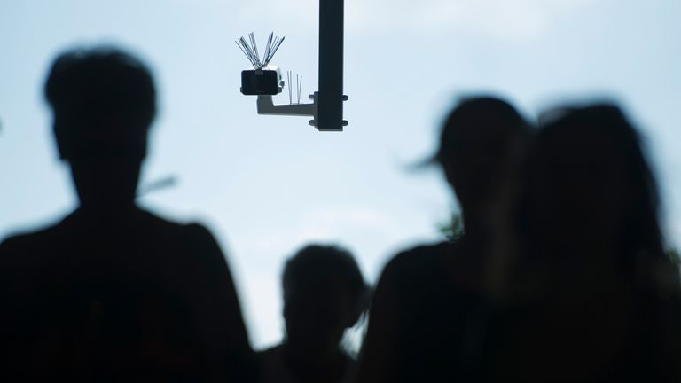 BERLIN, GERMANY - AUGUST 03: Passersby walk under a surveillance camera which is part of facial recognition technology test at Berlin Suedkreuz station on August 3, 2017 in Berlin, Germany. The technology is claimed it could track terror suspects and help prevent future attacks. (Photo by Steffi Loos/Getty Images)
