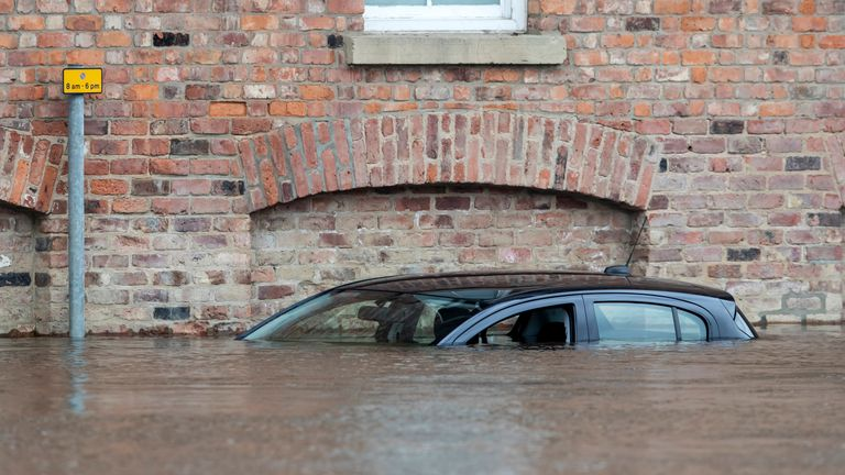 A car is submerged in flood water in York after the River Ouse burst its banks
