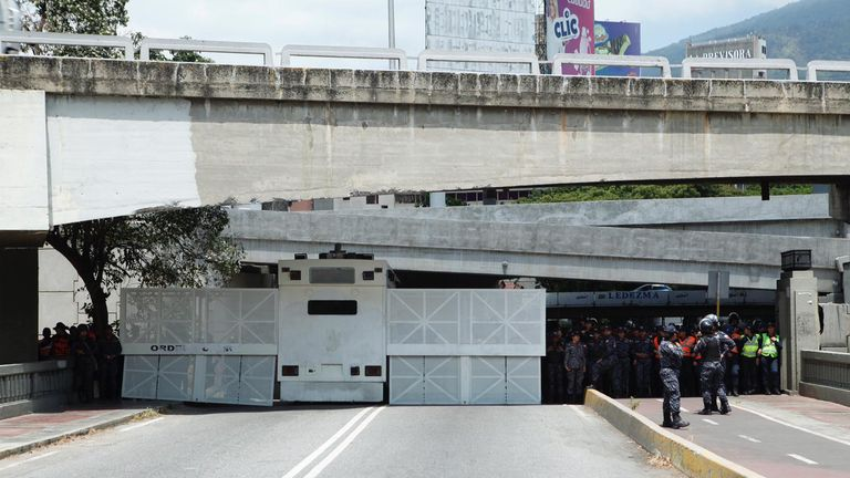 Bolivarian National Police block the road in the west of Caracas so demonstrators cannot go to the east to see Guaido
