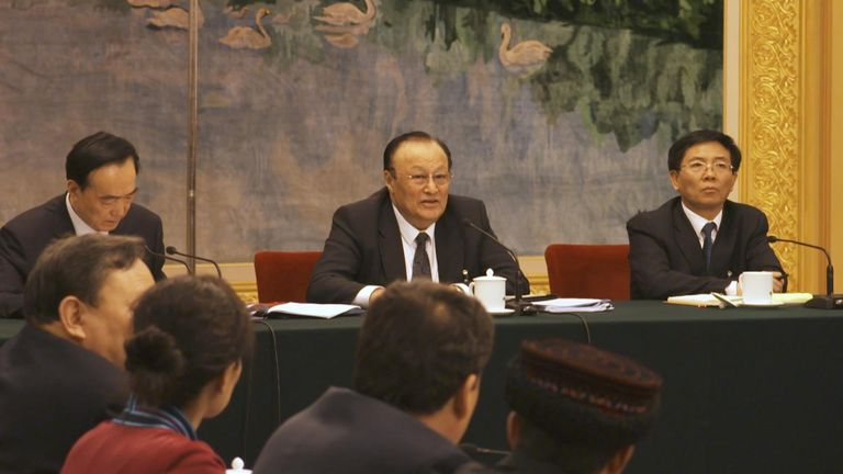 Shohrat Zakir (centre), the governor of Xinjiang region, at a rare press conference
