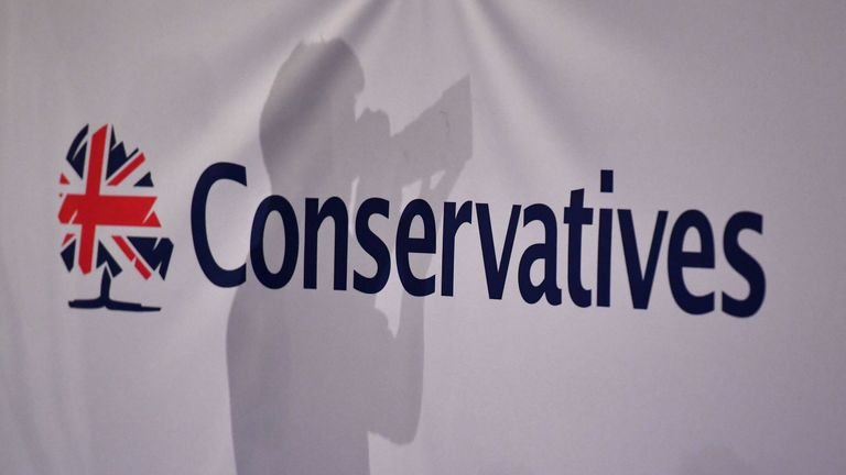 The background of a 'Conservatives' banner in the main hall on the first day of the Conservative Party Conference 2018