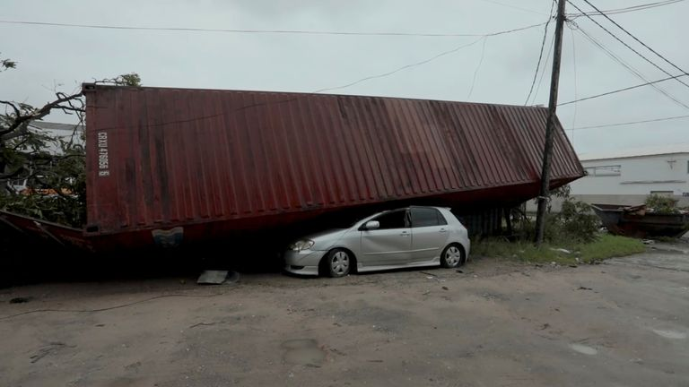 A car crushed by a shipping container after Cyclone Idai in Beira, Mozambique