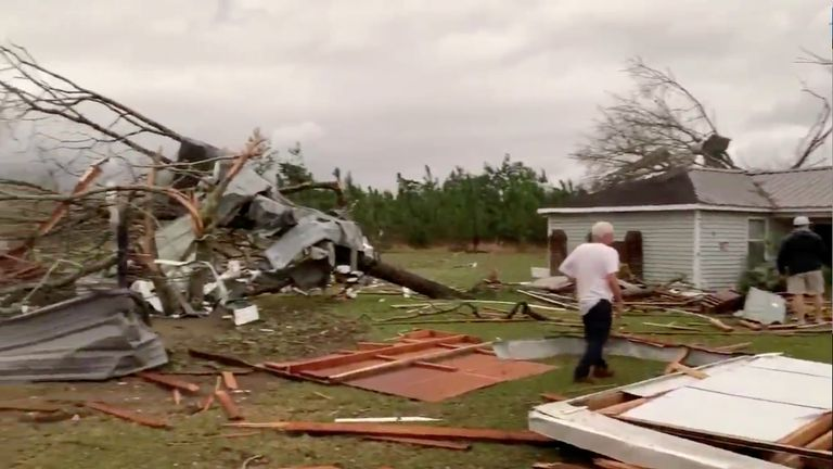 Debris of housing and snapped branches following the tornado