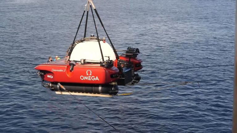 Rescuers retrieve a stricken mini-sub from the bottom of the Indian Ocean