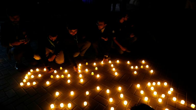 People light candles in Karachi, Pakistan