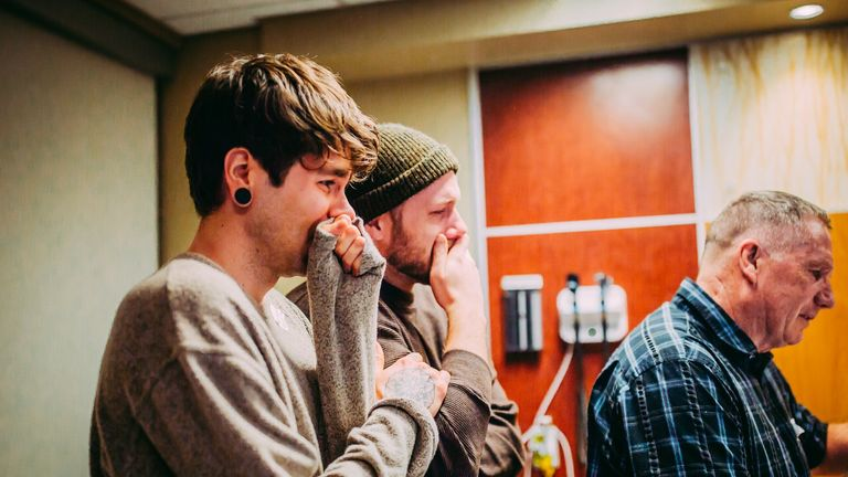 Elliot Dougherty (L) and Matthew Eledge are overcome with emotion at their daughter's birth