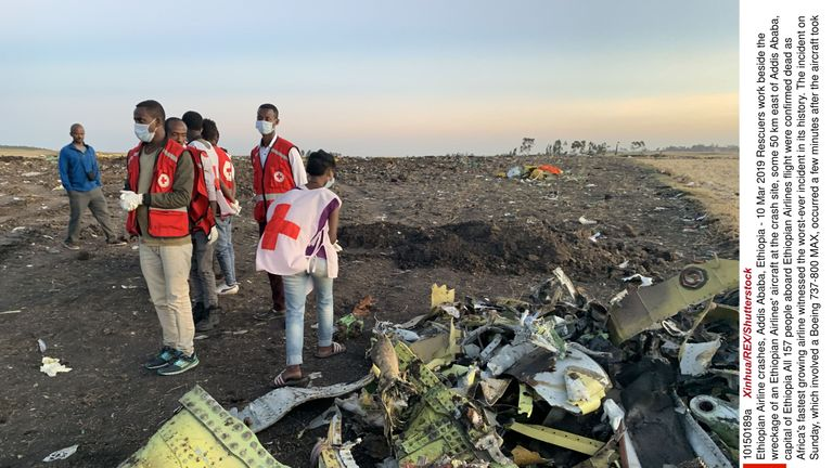 Rescuers work beside the wreckage of an Ethiopian Airlines' aircraft at the crash site, some 50 km east of Addis Ababa, capital of Ethiopia