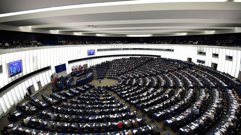 Members of the European Parliament take part in a voting session during a plenary session at the European Parliament, on February 13, 2019