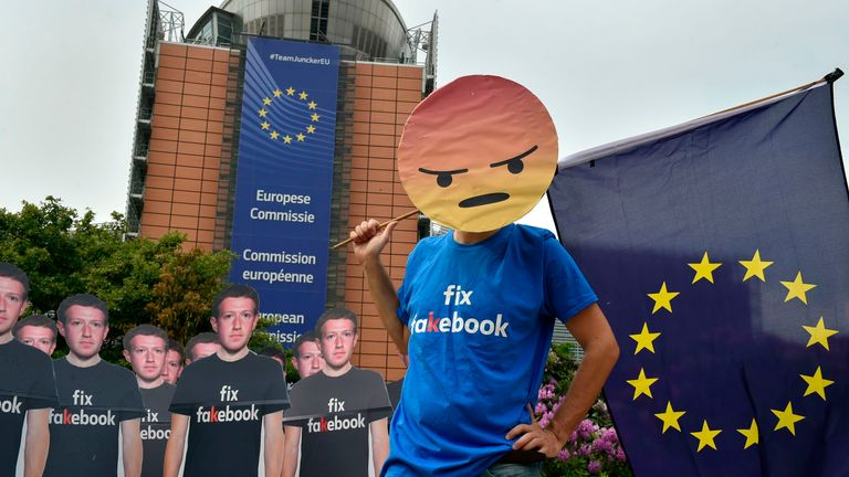 Global activists of Avaaz, set up cardboard cutouts of Facebook chief Mark Zuckerberg, on which is written 'Fix Fakebook