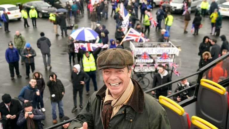 Farage poses in front of his brexit marchers in Sunderland