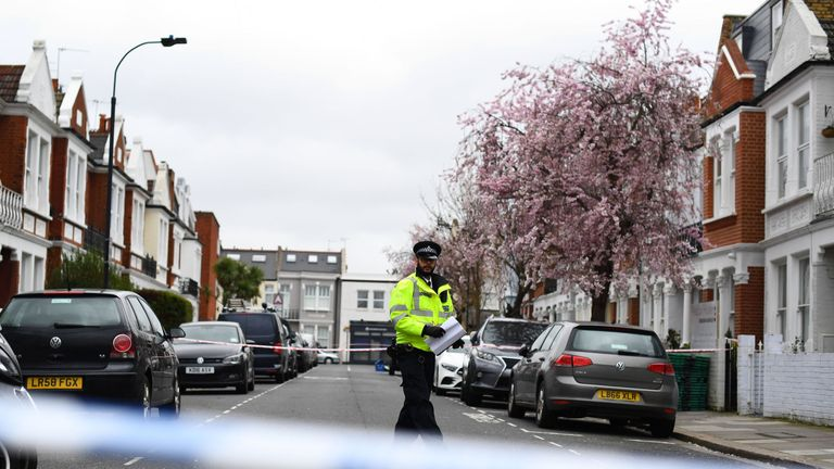 Police at the scene in Fulham, southwest London