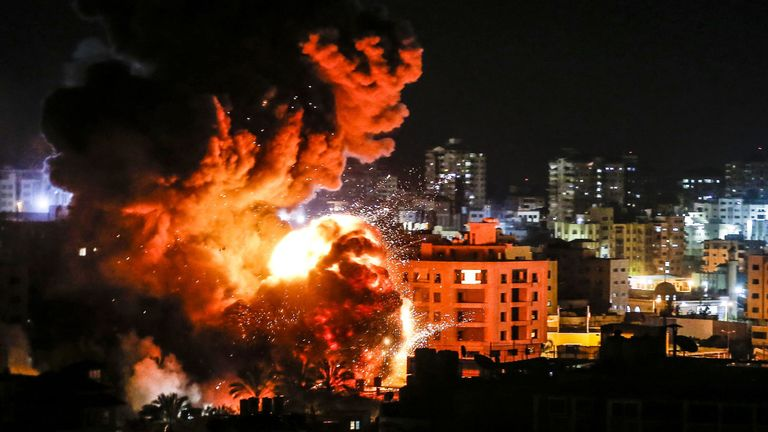 Fire and smoke billow above buildings in Gaza City during reported Israeli strikes on March 25, 2019. - Israel's military launched strikes on Hamas targets in the Gaza Strip today, the army and witnesses said, hours after a rocket from the Palestinian enclave hit a house and wounded seven Israelis