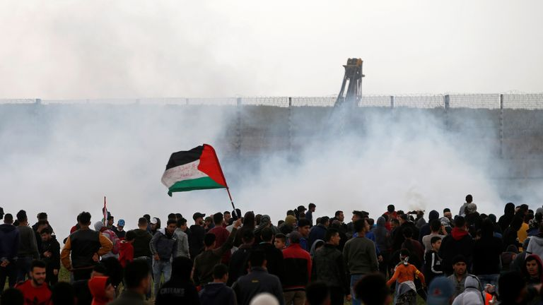 Palestinians gather as tear gas is fired by Israeli forces during a protest marking Land Day and the first anniversary of a surge of border protests, at the Israel-Gaza border fence east of Gaza City March 30, 2019. REUTERS/Mohammed Salem
