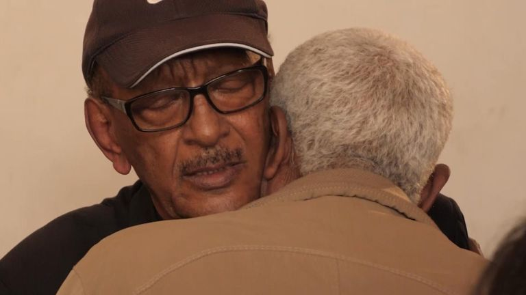 The pilot's father, Dr Getachew Tessema is comforted by a mourner