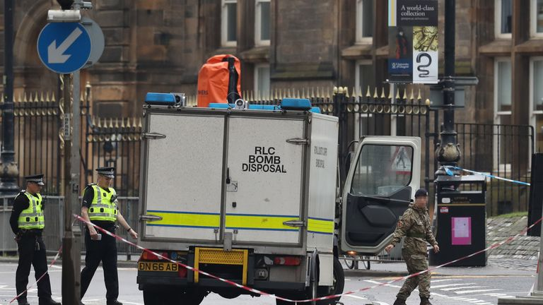 IMAGE PIXELLATED BY PA PICTURES Police and bomb disposal services outside the University of Glasgow after the building was evacuated when a suspect package was found in the mailroom.