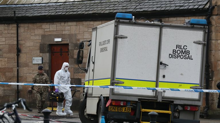 IMAGE PIXELLATED BY PA PICTURE DESK Royal Logistics Corps bomb disposal personnel leave the University of Glasgow's mailroom, where a suspect package was found leading to the evacuation of the building.