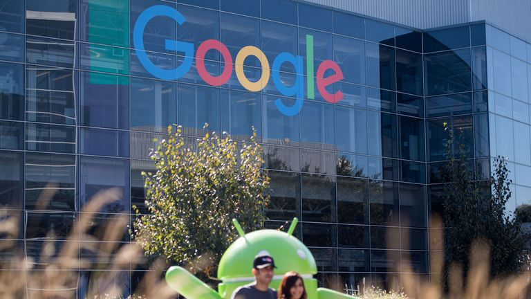 People pose for a picture near a Google sign and Android statue at the Googleplex in Menlo Park, California on November 4, 2016. / AFP PHOTO / JOSH EDELSON (Photo credit should read JOSH EDELSON/AFP/Getty Images)