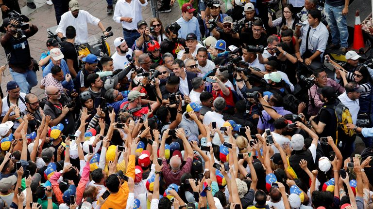 Venezuelan opposition leader Juan Guaido, who many nations have recognized as the country's rightful interim ruler, greets supporters during a rally against Venezuelan President Nicolas Maduro's government in Caracas, Venezuela March 4, 2019. REUTERS/Manaure Quintero