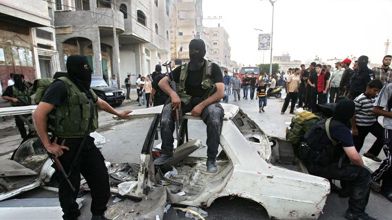 Hamas militants take a rest during clashes between rival forces of Hamas and Fatah movements in August 2008