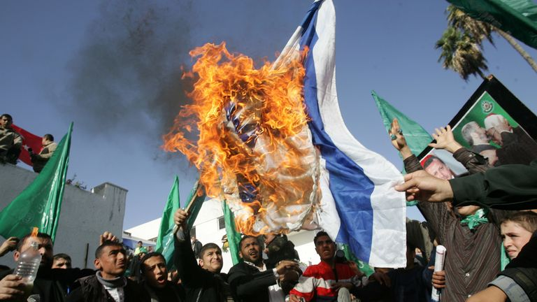 Hamas supporters burn an Israeli flag during a demonstration in Gaza in 2009