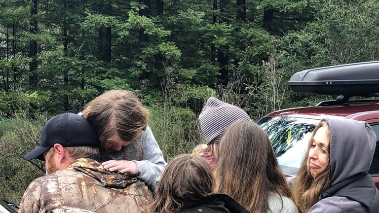 The missing girls are hugged after being found. Pic: Humboldt County Sheriff