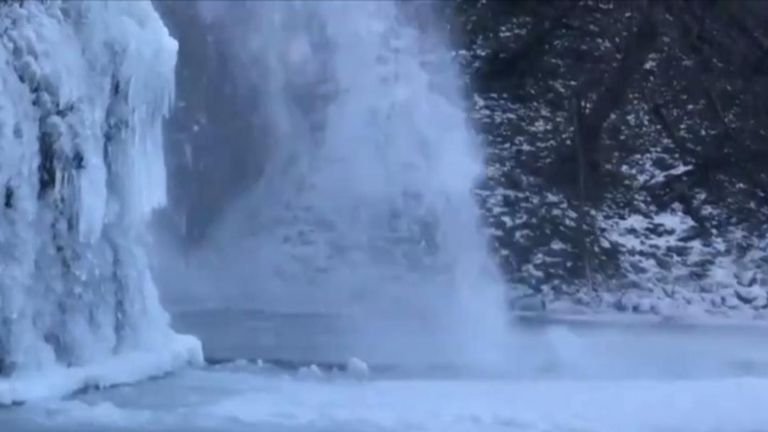 Icy waterfall in magical winter wonderland effect in Oregon