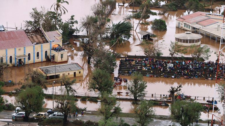 Residents gather stranded on the stands of a stadium in a flooded area of Buzi, central Mozambique, on March 20, 2019, after the passage of cyclone Idai