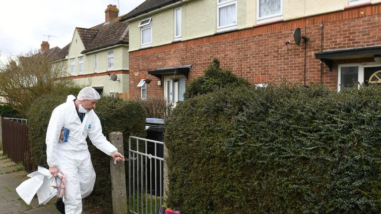 A forensics investigator outside a property on Swinburne Road, Ipswich following the sudden deaths of a woman and young child
