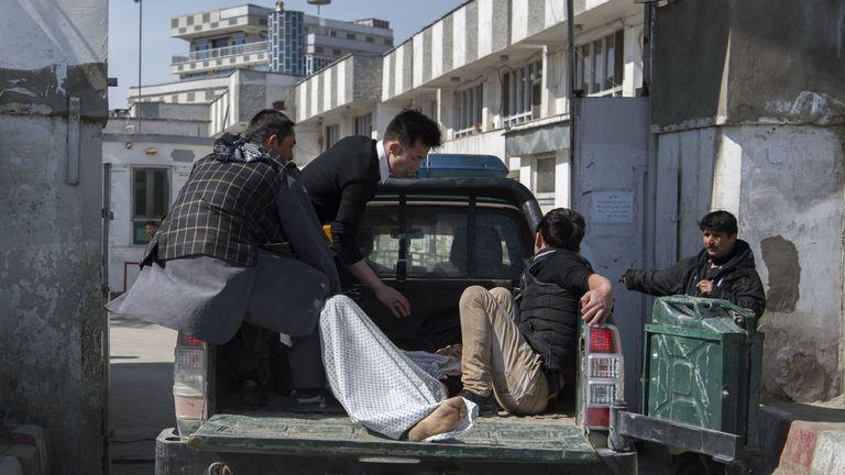 Patients are transfered to hospital after a mortar attack in Kabul in March which has been blamed on IS