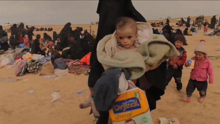 Mothers and children leave Islamic State-held territory in Baghuz, Syria