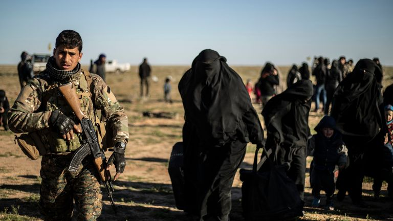 Women leaving the last IS holdout are directed by the SDF