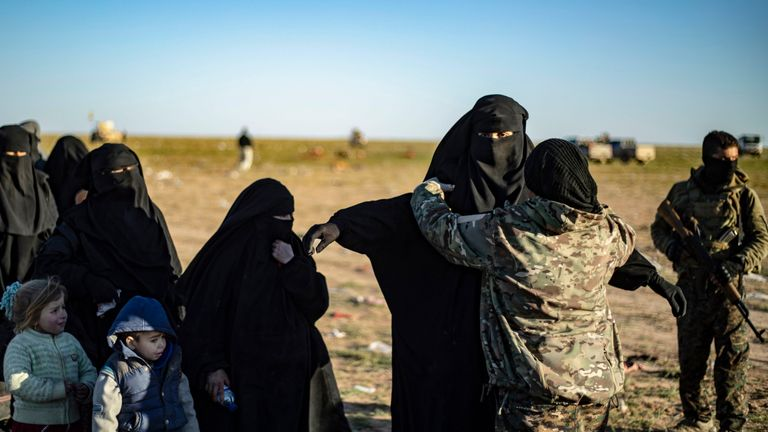 Women and children leaving Islamic State re searched by the SDF