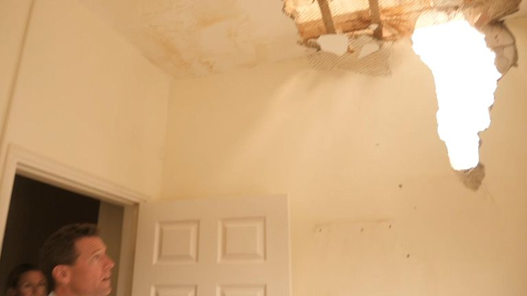 A rocket fired from Gaza punched through an upstairs wall at this house in Sderot