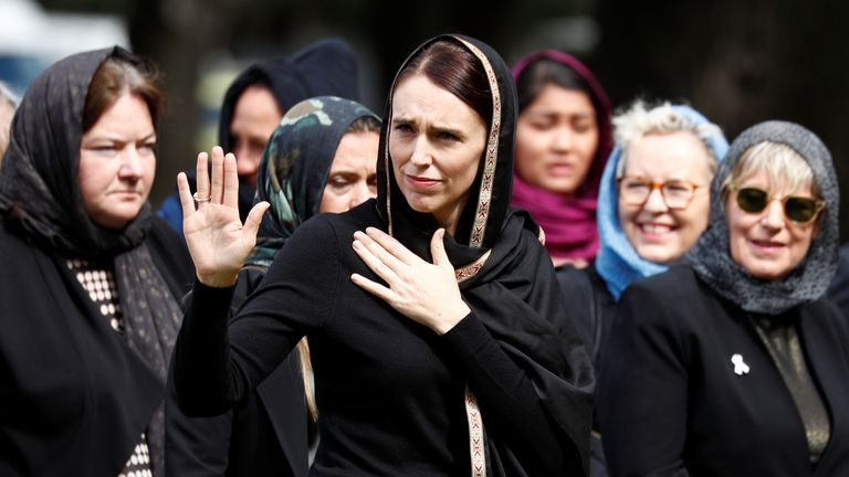 Jacinda Ardern waves as she leaves the vigil and prayers